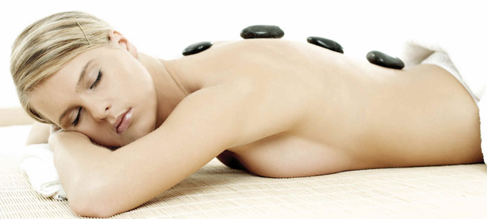 Tom Du TCM-Wellness-Massage  bietet auch Hot-Stone Massagen